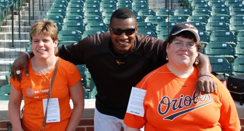 Mandy and her friend Cassie pose with their favorite Oriole Adam Jones